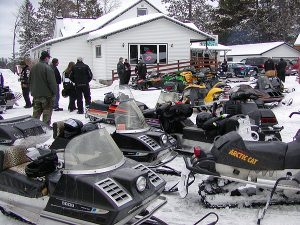 Lots of people at The Pines checking out the old snowmobiles